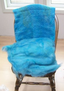 Curious Cross fiber batt dyed blues and resulting felt